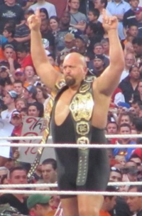 Big Show is an eight-time world tag team champion in WWE – factoring in both WWE Tag Team Championship (around right shoulder) and World Tag Team Championship (left shoulder) reigns