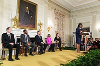 Boseman (second left) at the 42 film workshop in the State Dining Room of the White House in April 2013; First Lady Michelle Obama is delivering remarks.