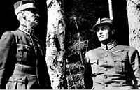 <center>Crown Prince Olav and his father King Haakon VII take shelter under birch trees as the German Luftwaffe bombs Molde</center>