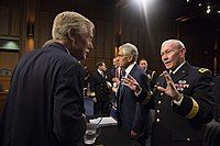 Martin Dempsey (right), speaks with King (left) at Senate Armed Services Committee meeting in 2014.