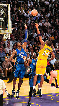 Bryant shoots a left-handed floater over future teammate Dwight Howard of the Orlando Magic on January 18, 2010.