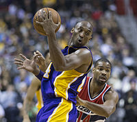 Bryant playing against Gary Neal of the Washington Wizards after announcing his forthcoming retirement, 2015