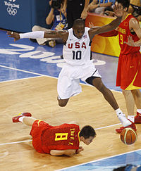 Bryant avoiding a collision in a game against China at the 2008 Summer Olympics