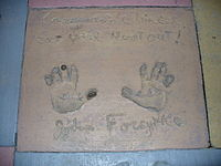 The handprints of John Forsythe in front of The Great Movie Ride at Walt Disney World's Disney's Hollywood Studios theme park.