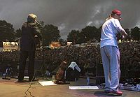 Simon Nicol and Ric Sanders of Fairport Convention on stage at Fairport's Cropredy Convention 2005