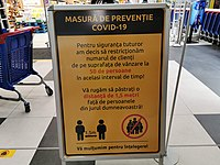 """""""Please keep your distance"""" notice in a Bucharest supermarket, 28 March 2020."""