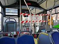 Barrier on bus to separate drivers from passengers in an effort to protect them from potential exposure to the COVID-19 virus