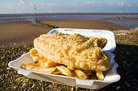 Fish and chips, a popular take-away food throughout the United Kingdom, has been described as the quintessential British dish.