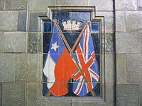 British and Chilean flags in a monument in Antofagasta city