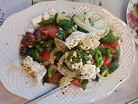 A Greek salad, with feta and olives.