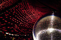 The reflective light disco ball was a fixture on the ceilings of many discothèques.