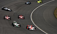 Carpenter (last car in picture) competing in the 2008 Indy Japan 300 at Twin Ring Motegi.