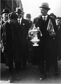 Spurs captain Arthur Grimsdell displaying the cup to fans on Tottenham High Road after the 1921 final