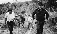 Omar Torrijos (right) with farmers in the Panamanian countryside. The Torrijos government was well known for its policies of land redistribution.