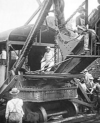 US President Theodore Roosevelt sitting on a steam shovel at the Panama Canal, 1906