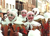 The Gilles of Binche, in costume, wearing wax masks