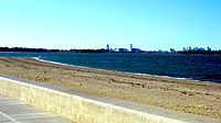 View of Marina Bay and Boston across Quincy Bay from Wollaston Beach.
