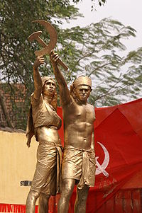 A tableaux in a CPI(M) rally in Kerala, India showing two farmers forming the hammer and sickle, the most famous communist symbol.