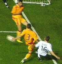 Milner (right) playing for the England under-21 team