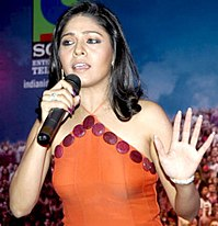 Chauhan performing at an event in 2006