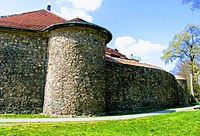 Medieval defensive walls and towers in Szprotawa, Poland, made of field stone and bog iron.