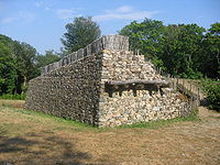 Reconstructed walls of Bibracte, a Gaulish oppidum, showing the construction technique known as murus gallicus. Oppida were large fortified settlements used during the Iron Age.