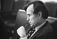 Bush, as CIA Director, listens at a meeting following the assassinations in Beirut of Francis E. Meloy Jr. and Robert O. Waring, 1976.