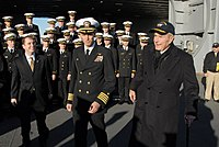 Capt. Kevin E. O'Flaherty, commanding officer of the aircraft carrier, escorts former president George H. W. Bush, 2009