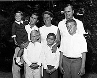Bush, top right, stood with his wife and children, mid 1960s