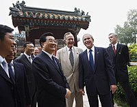 George H. W. Bush with son George W. Bush and China's president Hu Jintao in Beijing, People's Republic of China, August 10, 2008