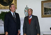 President Bush presents Senator Strom Thurmond with the Presidential Medal of Freedom in a ceremony in the Oval Office.