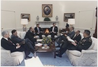 Bush meets with Robert Gates, General Colin Powell, Secretary Dick Cheney and others about the situation in the Persian Gulf
