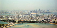 The cities of Muharraq (foreground) and Manama (background)