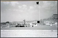 A photograph of the First Oil Well in Bahrain, with oil first being extracted in 1931
