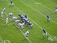 The College of the Holy Cross' football team (purple)