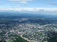 Worcester and the surrounding areas in 2006, looking north from 3700 feet (1128 m). Route 146 can be seen under construction.