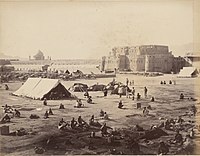 British and allied forces at Kandahar after the 1880 Battle of Kandahar, during the Second Anglo-Afghan War. The large defensive wall around the city was removed in the early 1930s by order of King Nadir.