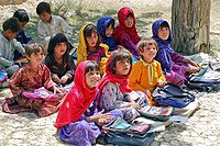 School children in Ghazni Province – the number of children attending school at primary level has increased from 5% in 2000 to 57% in 2018