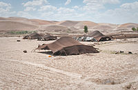 Tents of Afghan nomads in the northern Badghis province of Afghanistan. Early peasant farming villages came into existence in Afghanistan about 7,000 years ago.
