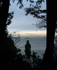 View of Siwash Rock taken from the forest trail above