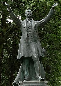"""Stanley Monument, unveiled 19 May 1960, depicting Stanley dedicating the Park """"To the use and enjoyment of people of all colours and creeds and customs for all time"""""""