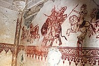 On the north side wall of the memorial shrine, a 16th-century art in traditional style depicting Ajaji on the horse attacking Mirza Aziz Koka on an elephant.