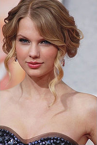 Pictured at the premiere of Hannah Montana: The Movie, Swift had a cameo appearance in the film and recorded two songs for its soundtrack.
