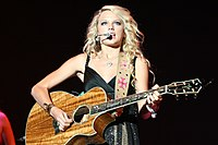 Swift opening for Brad Paisley in 2007. To promote her debut album, Swift opened for other country acts' tours in 2006–2007.