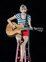 Swift performing on the Red Tour in 2013