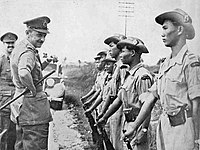 Sir Gerald Templer and his assistant, Major Lord Wynford, inspecting the Kinta Valley Home Guard (KVHG), Perak, c.1952