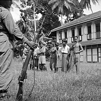 Suspected communist collaborators, believed involved in murders of civilians in Kuala Kangsar, under guard during an operation by the 53rd Indian Brigade (25th Indian Division), c.1945