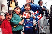 Fifth-wave Canadian children celebrating Canada Day in Vancouver, 1 July 1999