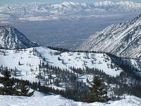 Looking down and westward at the city and the Oquirrh Mountains