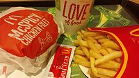 """A typical """"eat-in"""" McDonald's meal as sold in Hong Kong, consisting of French fries, a soft drink, and a """"main product"""" – in this case, a McSpicy Chicken Fillet. Condiments are supplied in small packets; such a packet of tomato ketchup is seen in the foreground."""